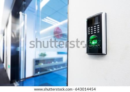 fingerprint scanner on wall #643014454