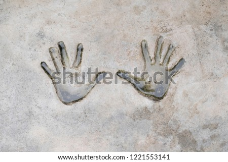 Fingerprints of human on cement. Background and texture of fingerprints. Wet and dirty of fingerprints human on cement.  #1221553141