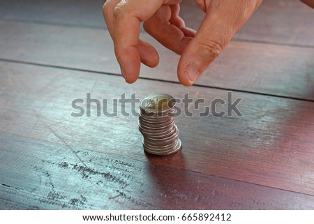 Fingers and Coins. #665892412