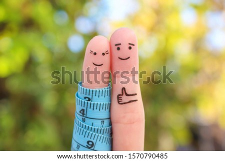 Fingers art of a Happy couple with tape measure. Concept of losing weight together.