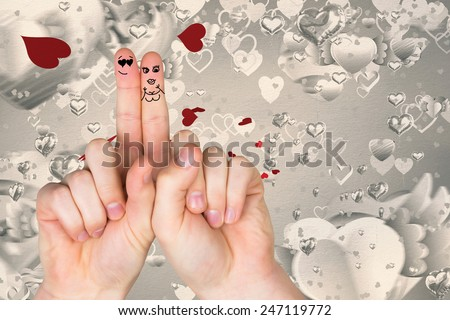 Fingers crossed like a couple against love heart pattern