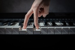 fingers follow the piano keys, the concept of the first steps in music, learning to play a musical instrument,