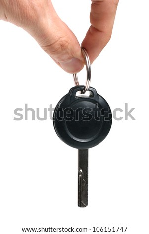 fingers hold the car key