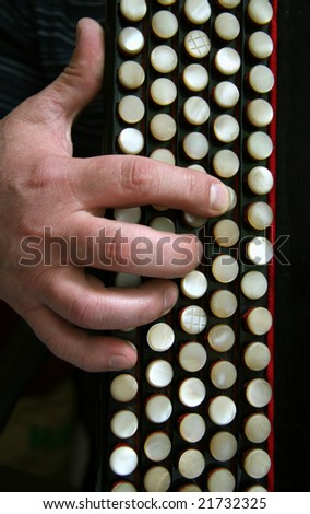 Fingers on the keyboard of a bayan close-up