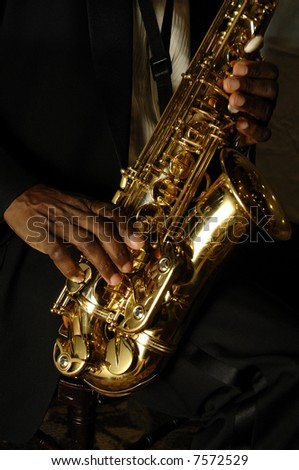 fingers playing a saxophone