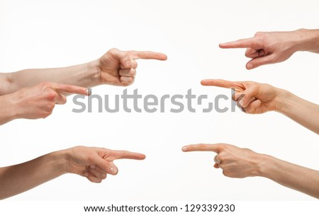 Fingers point to each other on white background