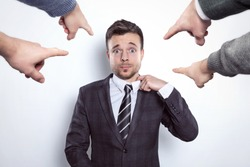 Fingers pointing at a businessman