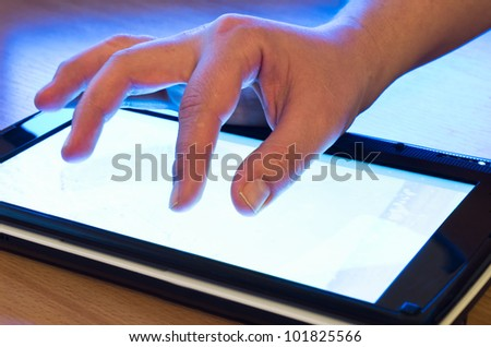 fingers touching screen on tablet-pc