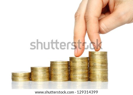 Fingers walking down on stacks of coins on white background. Decline concept