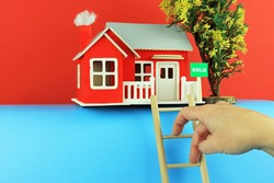 fingers walking Up A Ladder. Climbing The Property Ladder Concept.