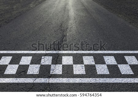 Finish and start pattern line on the sunny straight asphalt race road. #594764354