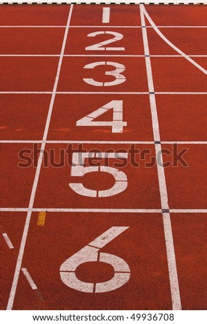 Finish line numbers on red running track