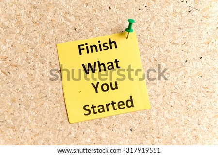 finish what you started word typed on a paper and pinned to a cork notice board