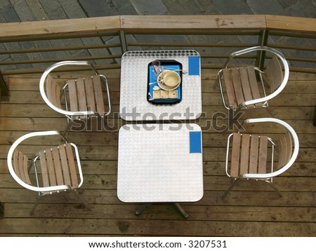 Finished Meal -- view of an outdoor restaurant table from above