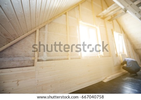 Finishing made of tongue and groove planks. An interior view of unfinished home inside. Work in process.
