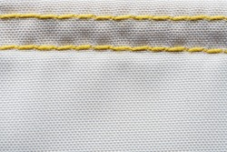 Finishing seam of a sports backpack close-up shot. Sport nylon fabric texture
