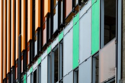 Finishing the facade of the building with a ventilated facade. A fragment of a residential building, hotel, hospital or other commercial property with glazed windows and building loess.
