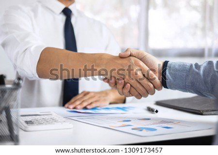 Finishing up a meeting collaboration, handshake of two business people after contract agreement to become a partner, collaborative teamwork.