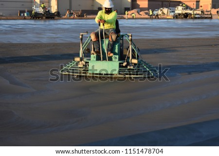 Finishing Wet Concrete with a Ride-on Trowel