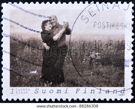 FINLAND - CIRCA 1997: A stamp printed in Finland shows an older couple dancing in the field, circa 1997