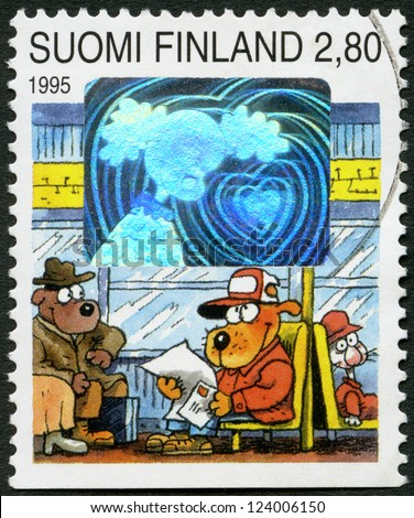 """FINLAND - CIRCA 1995: A stamp printed in Finland shows """"Dog Hill Kids"""", sending/receiving greetings: On bus, girl friend, circa 1995"""