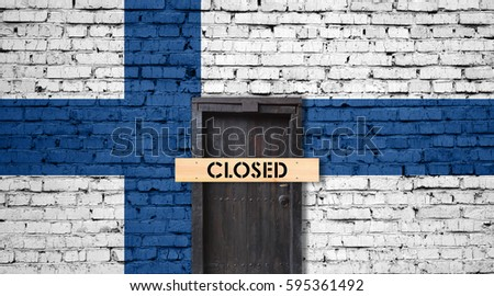 Finland flag on brick wall with closed door and Closed sign #595361492