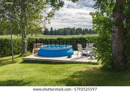 Finnish country house yard. Playground. Children's playhouse. Inflatable pool in the yard. Сток-фото ©