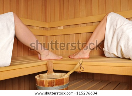 Finnish sauna with the legs of two women