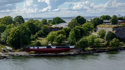 Finnish submarine-museum ship Vesikko on the shore of Artillery Bay at Susisaari island of Suomenlinna. After Finland was banned from operating submarines, Vesikko is the last survived in the country.