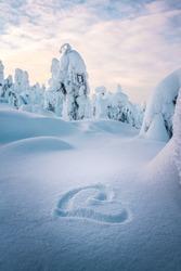 Finnish winter wonderland. Holiday in a snowy winter wonderland. Snowy mountain travelling.
