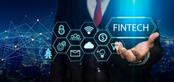 Fintech (financial technology) concept. Business person hold fintech illustration and icon technology.5G network wireless systems.IoT(Internet of Things), ICT,communication network concept.