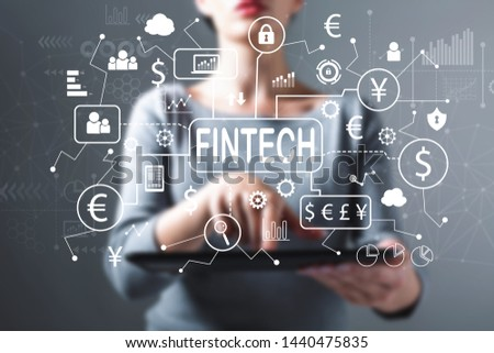 Fintech theme with business woman using a tablet computer #1440475835