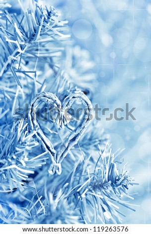 Fir branch and straw heart shape in blue