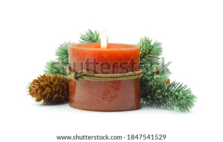 Fir branch with Christmas tinsel and candle .Fir branch with Christmas tinsel and  candle. Christmas and New Year festive background. Isolated on white.