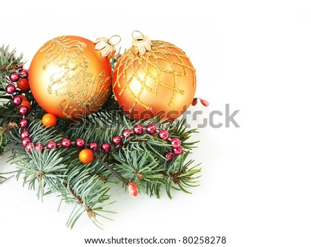 fir branches and Christmas balls over white