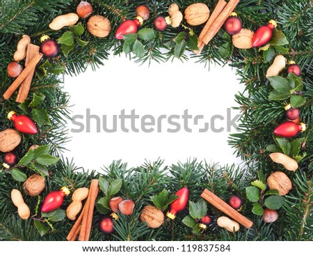 fir branches, apples, nuts, pine cones and christmas tree balls/christmas/decoration