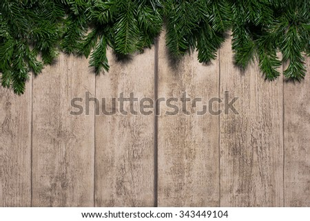 fir on wooden background . card concept #343449104