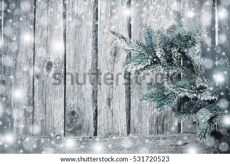Fir tree covered with snow on wooden board #531720523