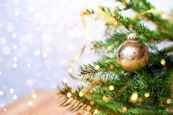Fir-tree spruce with Christmas golden decor balls. Holiday background.