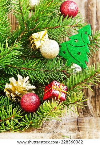 Fir Tree with Christmas Tree Decoration and Glitter Balls and Gifts on Wooden Background