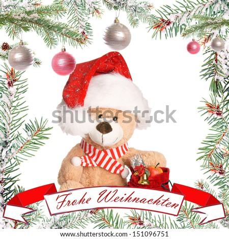 Fir twig frame with teddy and banner with the german words merry christmas / christmas time