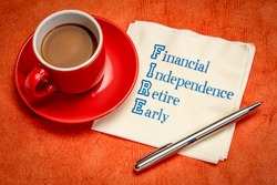 FIRE acronym - financial independence, retire early, handwriting on a napkin with a cup of coffee