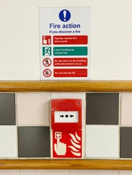 Fire action plan sign and manual fire alarm point in public work place