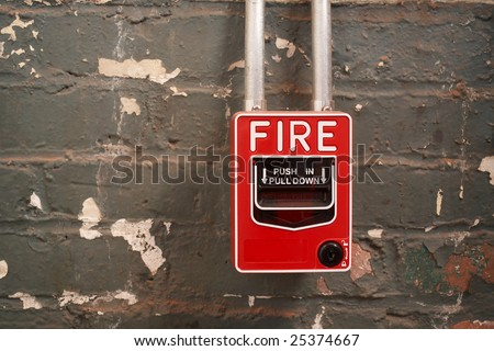 Fire alarm on old brick wall