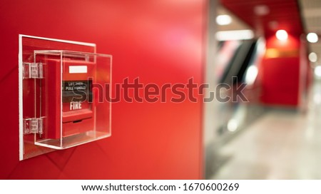 Fire alarm on the wall in subway in Bangkok,  At the Bangkok subway fire warning equipment for emergency. It's red fire alarm switch  on the wall. Founded un everywhere for the public area.