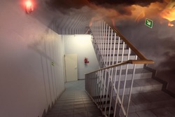 fire and an escape route in the staircase in the building