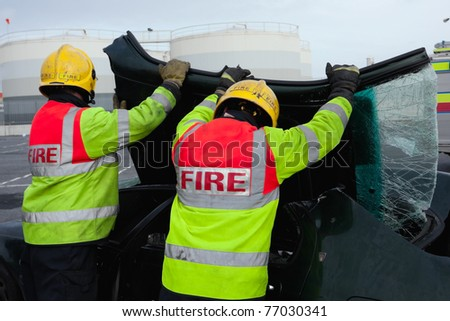 Fire and Rescue emergency Units at car accident removing broken wind screen