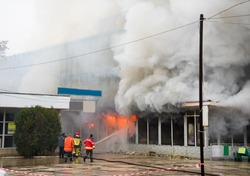 Fire and strong smoke covered building