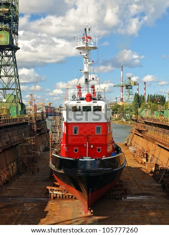 Fire-boat in floating dry dock. Gdansk, Poland.