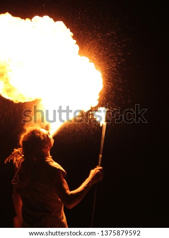 fire breather blowing big fire ball with flammable liquid stock, photo, photograph, picture, image,